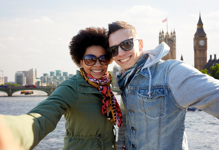 couple taking selfie in front of Big Ben in England